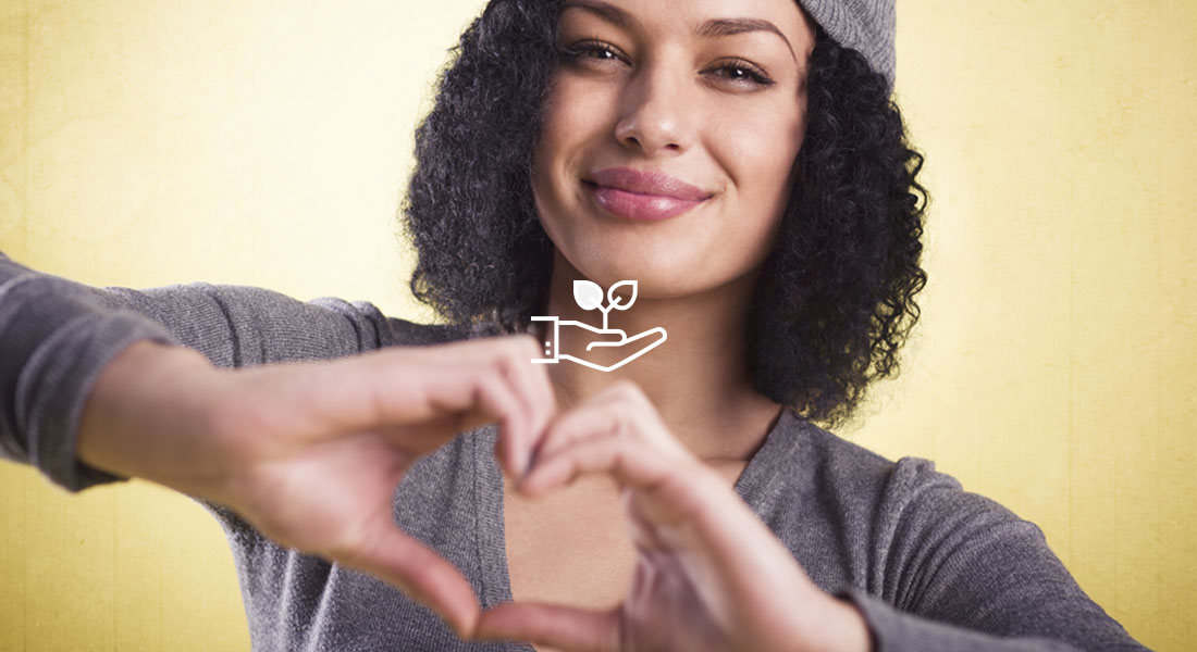 Bigstock Image: Young woman making a hand heart.